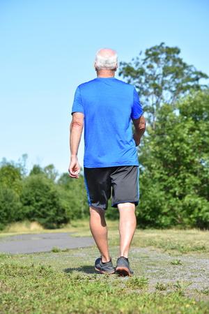 Male Senior Alone Exercising