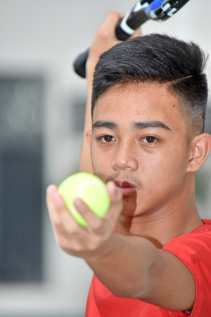 Unemotional Fit Asian Male Tennis Player 写真素材