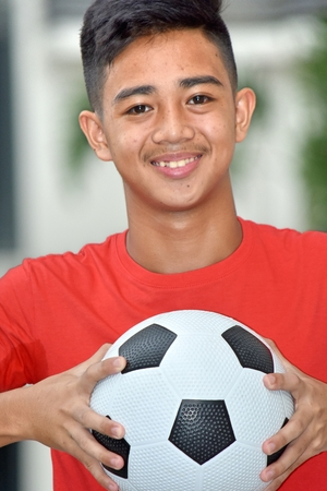 Smiling Filipino Male Soccer Player With Soccer Ball Stock Photo