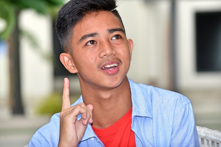 Asian Teenage Male Having An Idea
