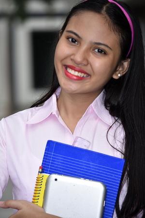 Youthful Filipina School Girl Smiling 스톡 콘텐츠