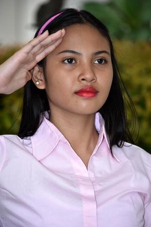 Youthful Minority Female Saluting