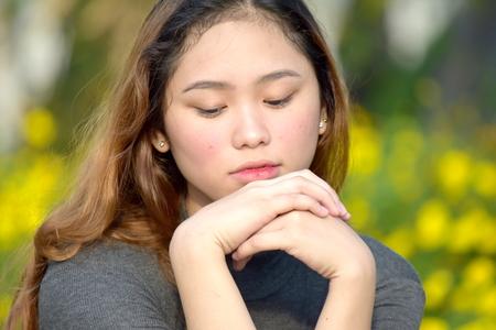 Youthful Minority Woman Alone