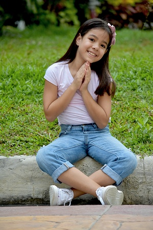 Praying Petite Filipina Girl 写真素材