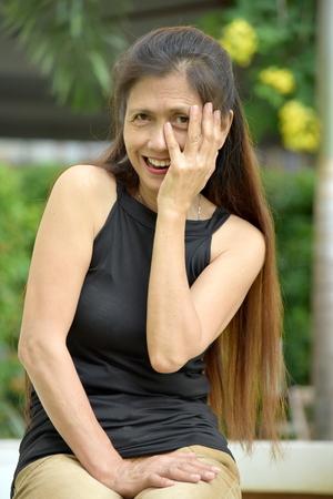 Bashful Old Filipina Woman