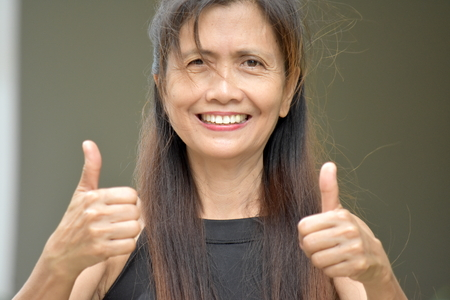 Minority Grandmother With Thumbs Up Stock Photo