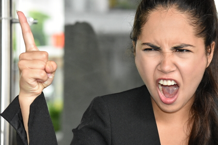Colombian Business Woman And Anger Wearing Suit Stockfoto