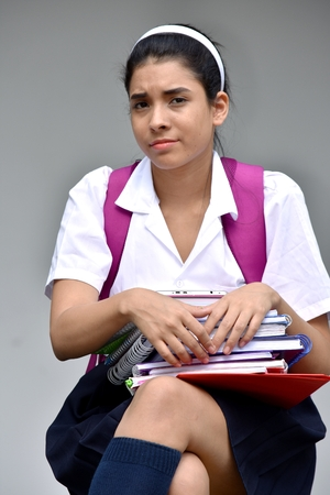 Unhappy Cute Colombian Girl Student Wearing School Uniform