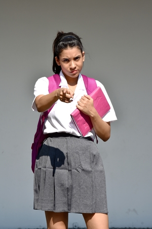 Pointing Cute Colombian Student Teenager School Girl With Notebook 스톡 콘텐츠