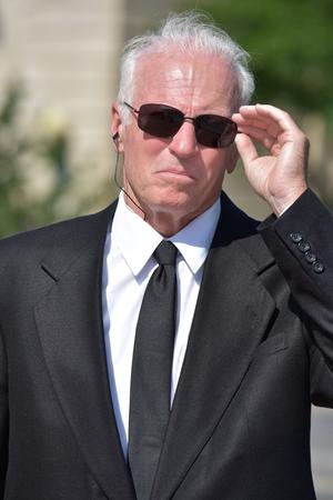 Portrait Of A Bodyguard Wearing Sunglasses