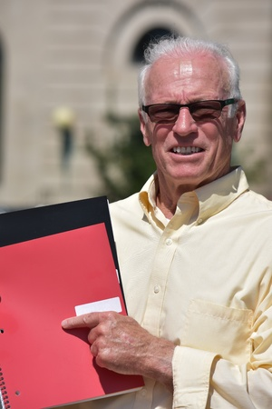 Adult Male Teacher Pointing Wearing Sunglasses With Notebooks