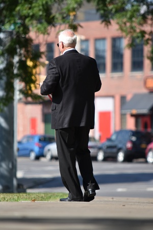 Adult Male Politician And Failure Wearing Suit And Tie Walking On Sidewalk