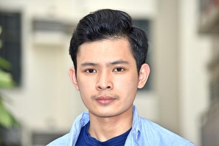 Unemotional Young Minority Teenager Boy Stock Photo