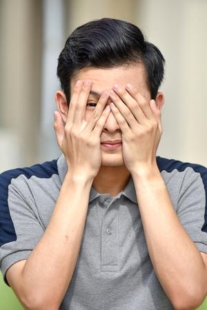 Ashamed Youthful Filipino Teen Boy