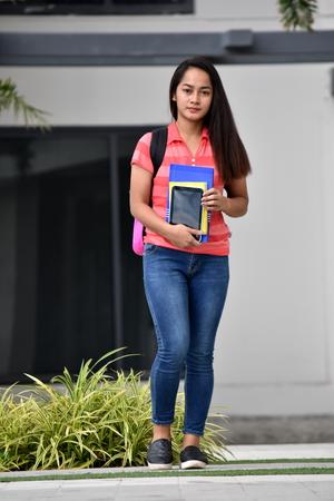 Beautiful Minority Student Walking On Campus