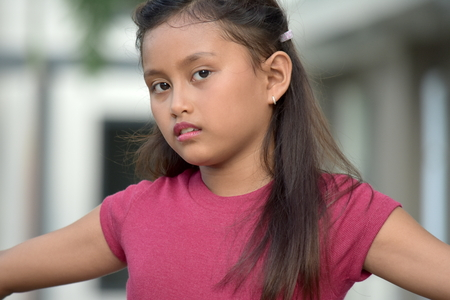 Serious Cute Filipina Person Stock Photo - 115117126