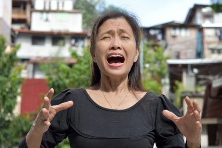 Retired Filipina Female Senior And Anger Banque d'images
