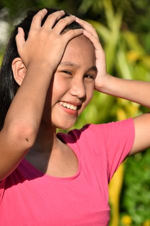 Forgetful Asian Girl Youth 版權商用圖片