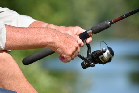 Fisherman Holding Fishing Rod Banco de Imagens