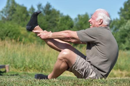 Army Senior Male Veteran Stretching