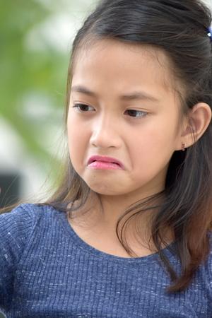 Unhappy Petite Asian Girl