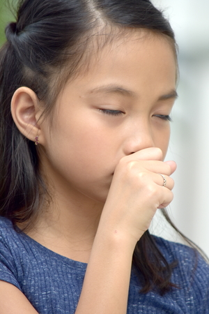 Cute Diverse Teen Girl Coughing Stock Photo