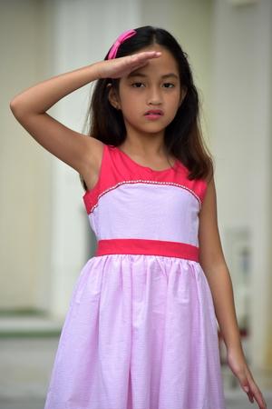Young Asian Juvenile Saluting