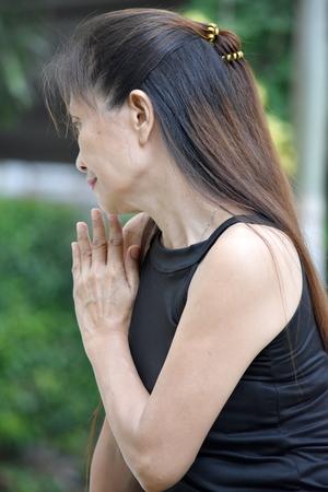 Minority Female Senior Alone