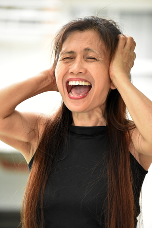 Anxious Asian Person Stock Photo