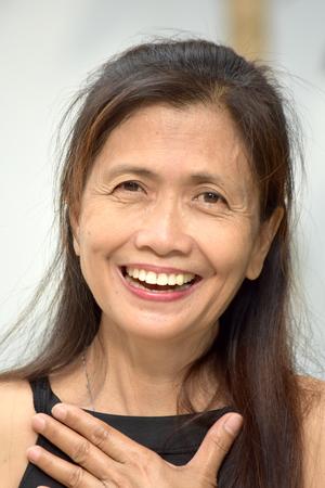 Appreciative Female Senior Foto de archivo - 115759885