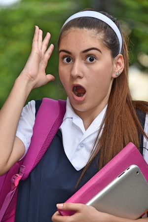 Surprised Catholic Colombian Girl Student With Books Stok Fotoğraf