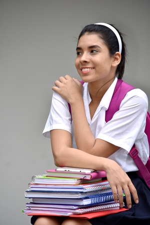 Portrait Of A Student Teenager School Girl With Textbooks