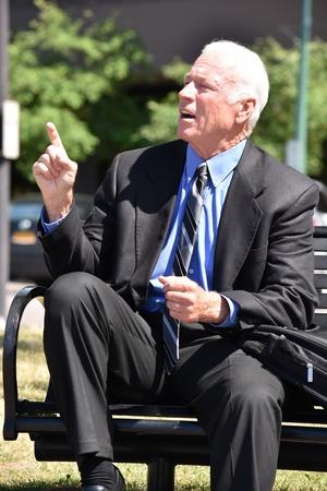 Creative Senior Business Man Wearing Suit Sitting Banque d'images