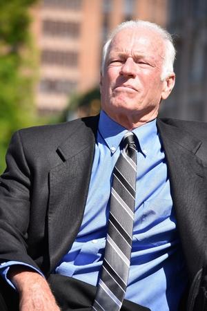 Unemotional Adult Senior Investor Sitting Stock Photo