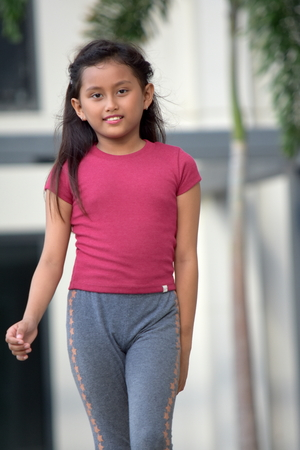 Cute Filipina Female Walking Stock Photo - 115760741