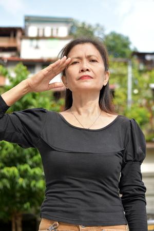 A Female Senior Saluting