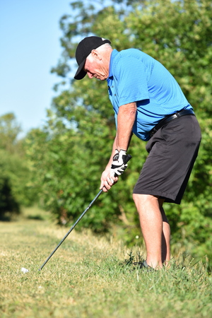 Athletic Man And Exercise With Golf Club Swinging