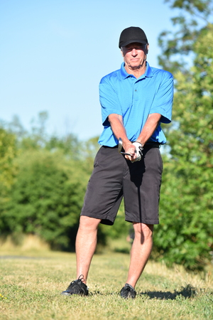 Fit Adult Male Athlete Posing With Golf Club