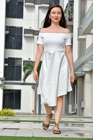 Happy Adult Female Wearing Summer Dress Walking 免版税图像