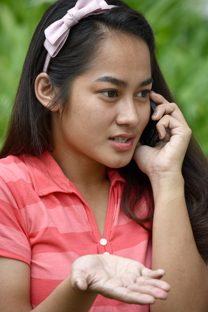 Girl Using Cell Phone And Unhappy