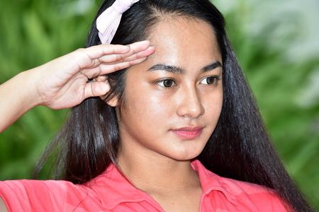 Youthful Asian Teenager Girl Saluting