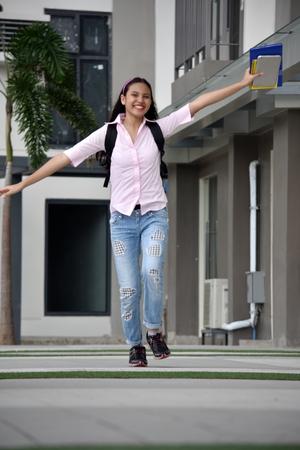 Fun Student Teenager School Girl With Books Foto de archivo