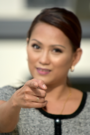 An Asian Female Pointing