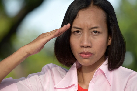 Young Filipina Female Saluting