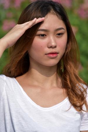 A Filipina Female Saluting