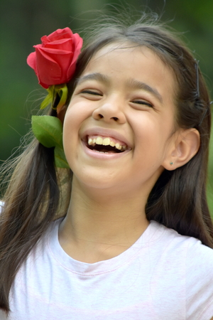 Preteen And Laughter With A Rose