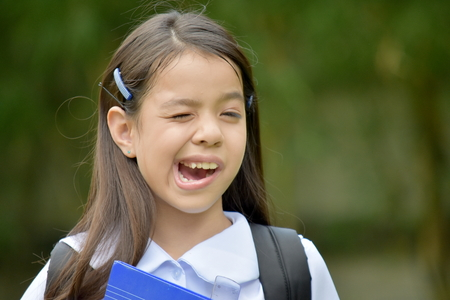 Child Girl Student Making Funny Faces Wearing School Uniform With Notebooks