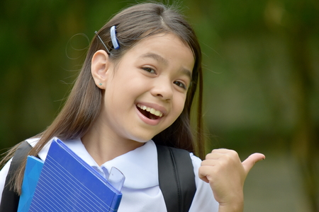 Girl Student And Happiness With Books Foto de archivo