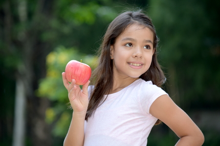 Diverse Girl And Happiness With An Apple