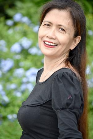 Older Filipina Female Senior And Happiness